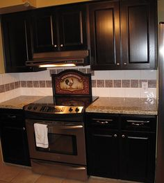 New Kitchen by Kitchen Solvers (Surry, BC). Beautiful dark cabinets with tiled backsplash.