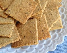 Prep time: 10 min • Cook time: 14 min • Yield: approx. 48 crackers Ingredients * 1 cup sesame seeds, toasted * 1 cup almond flour * ¼ cup coconut flour * 2 tablespoons arrowroot * 1 teaspoon Celtic sea salt * 1 teaspoon garlic powder * ½ teaspoon freshly ground pepper * 1 teaspoon dried Herbes de Provence, or any combination of herbs you like * 3 tablespoons ghee, melted, or extra virgin olive oil if you use it in baking * 2 large eggs D...