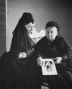 Photograph of Queen Victoria (1819-1901) with Victoria, Princess Royal, Empress Frederick, both wearing black in mourning holding a photograph of Emperor Frederick III who died in June 1888, photo was taken june 1889 | The Royal Collection