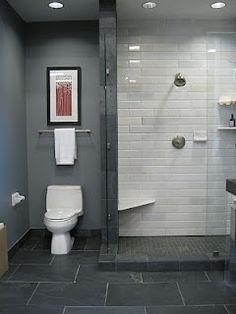 The Tile Shop: san dona marble shower walls, adoni black floor, and shanxi black flamed granite floor