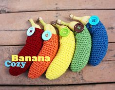 Banana cozy by http://www.repeatcrafterme.com/2011/10/going-bananas.html pattern can be found here as pdf http://fc01.deviantart.net/fs40/f/2009/014/a/3/Crochet_Banana_Cozy_Pattern_by_Eyespiral_stock.pdf