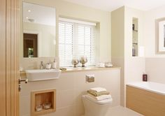 This stunning traditional style bathroom at St Irvyne's, Horsham. The concealed wall compartments provide extra storage and the bath provides the perfect place to relax.