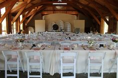 White wedding chairs and long tables for the reception.