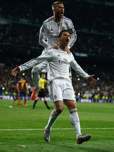 Cristiano Ronaldo of Real Madrid celebrates his team's third goal with Sergio Ramos of Real Madrid during the La Liga match between Real Madrid CF and FC Barcelona at the Bernabeu on March 23, 2014 in Madrid, Spain.