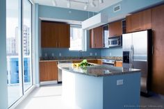 """Modern Monday"" Kitchen of the Day: Blue walls, cherry cabinets, and a spectacular view of the city skyline give this urban kitchen an enlarged, luxurious feel. Kitchen Design Gallery, Modern Kitchen Design, Kitchen Designs, Kitchen Ideas, Wood Kitchen Cabinets, Kitchen Backsplash, Kitchen Walls, Kitchen Time, Kitchen Dining"