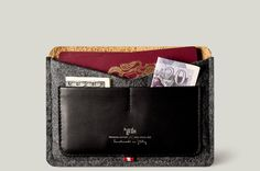 A slim passport case that holds a couple of passports and two credit cards.