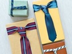 Necktie-Inspired Bow: Learn how to wrap this a gift for your favorite fella with a tie-inspired bow. Perfect for my husband's college graduation / new job celebration!