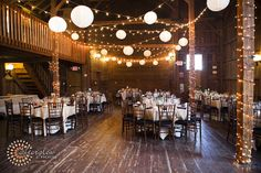 Barn, lanterns, string lights, rustic, wedding  By Afterglow Photos