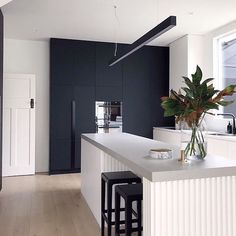 The island bench, sleek black cabinetry and pendant light...so much to love about this kitchen by @petraholain Regram @buildhercollective .…