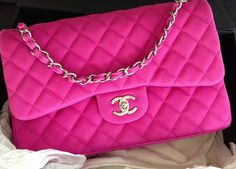 Bubblegum pink matte double flap chanel bag. Ugh! Want.