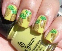 Konad pineapples on nails .