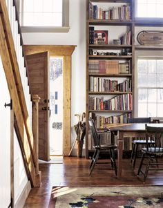 Give you foyer a grand entrance effect by allowing light through and adding a towering bookcase.