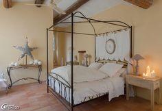 Four poster bed 'Maisons du Monde', Linens 'Le Trousseau On Anath', star lit painted canvas, creating 'Rose Velvet' in L'Isle-sur-la-Sorgue, table lamp 'Chehoma'