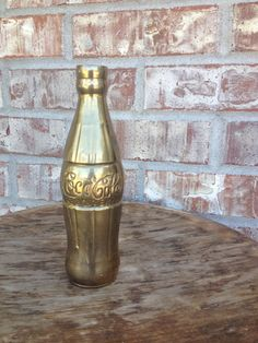 Awesome 1970s Vintage Brass Coca Cola / Coke Bottle / Flower Vase - Vintage Coca Cola Collectibles    Love this... What an awesome SPIN on a classic