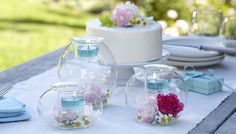 BEAUTIFUL! light blue candles, flowers, hand blown glass holders, centerpiece, weddings, birthday, parties, theme, decor