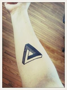 done by TJ at Tattoo in SF. This is a Penrose Triangle a geometric figure impossible to reproduce in a tri-dimensional space. It was named after a swedish mathematician from the who called it the most beautiful way to express impossible Triangle Tattoo Meaning, Triangle Tattoos, Tattoos With Meaning, Geometric Triangle Tattoo, 3d Triangle, Tattoo Skin, Tattoo You, Triangle De Penrose, Future Tattoos