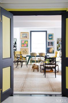 Love the black and yellow doors and chairs. The subtle animal print carpeting is gorgeous.