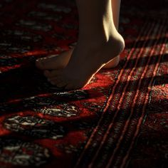 She danced lightly on the balls of her feet, carefully swaying her hips and casting shadows onto the carpet.