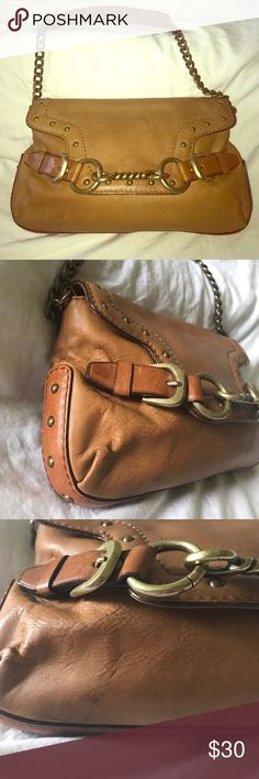 Michael Kors Leather Baguette Purse Cute bag for the essentials. It comes in a brown leather with brass hardware and stud accents. Shows soiled spots inside and out. Normal wear. Michael Kors Bags Mini Bags