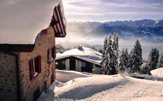 Holiday Houses On A Snowy Mountain Top wallpaper free