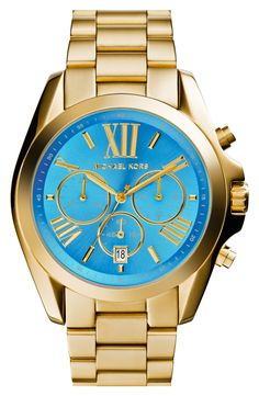 "The ultimate statement watch: Gold MMK ""Bradshaw"" watch with a turquoise face."