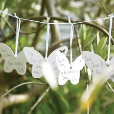 Butterfly wishes kit - designed to be hung on twigs or on a tree at your venue - paper butterflies on ribbons for your guests to write their wedding wishes for you.  A great and stylish alternative wedding guest book. --- $34.95 Butterfly Wishes Kit (Contains 54 Cards)