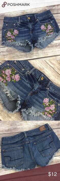 """AEO Shorty Floral Embroidered Shorts Denim shorts with pretty Floral embroidery by American Eagle Outfitters. Cut off style. Made of 99% cotton and 1% spandex. Very good condition with no flaws. Approximate 2"""" inseam. ⚓️No trades or holds. I negotiate only through the offer button. Any measurements listed are approximate since I am not a seamstress. 🚭🐩T1 American Eagle Outfitters Shorts Jean Shorts"""