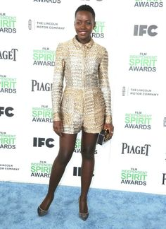 Best Supporting Female award winner Lupita Nyong'o in our Summer '14 python print all in one at the 2014 Film Independent Spirit Awards in Santa Monica, California