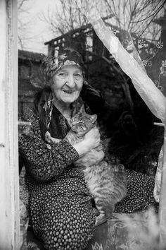 happy with her cat - null