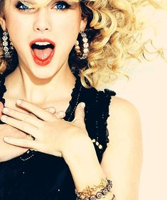 TAYLOR SWIFT- has awesome hair and awesome music just wish she would right some thing other then love