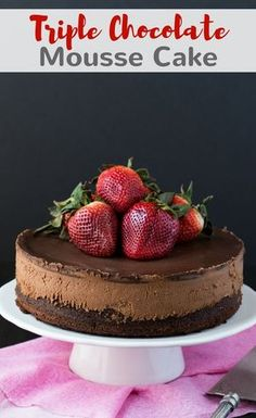 Triple chocolate Mousse Cake made with a chocolate cake base, cool creamy mousse filling and topped with rich dark chocolate ganache. #chocolate #mousse #cake #dessert #baking via @introvertbaker