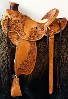 Cowgirl Cates' Orchid Wade Saddle, light weight Wade with Orchid Floral tooling. Cowboy Gear, Cowgirl And Horse, Western Horse Tack, Cowgirl Style, Western Saddles, Leather Carving, Leather Art, Saddle Leather, Wade Saddles