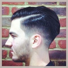 Gents haircut. Faded sides with Enhanced side parting shaved in. Slick groomed finish.