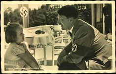 Hitler with a young girl at the Berghof 1938.(800x516)  So odd to see a picture like this...he's still creepy when he's smiling...