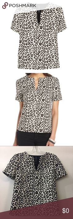 W118 By Walter Baker Leopard Randi Top Stunning leopard top for any occasion. Mid-weight stretch leopard jacquard. Notch v-neck. Short sleeve contemporary fit. Made out of 100% Polyester. Excellent condition. Open to reasonable offers! W118 by Walter Baker Tops Blouses
