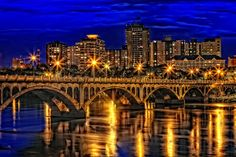 The golden glow of Saskatoon's city lights and the University Bridge across the South Saskatchewan River. Places To Travel, Places To See, Riding Mountain National Park, O Canada, Visit Canada, Canadian Prairies, Land Of The Living, Saskatchewan Canada, Canadian Travel
