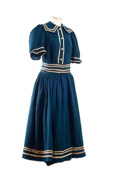 Woman's two piece bathing suit, 1890s. All made of deep blue wool, the shirt and pants are one piece with a gathered overskirt for modesty. The white trim is cotton twill tape, giving it a nautical flair. To complete the look, the bather would have worn a gathered cap, stockings, bathing shoes and perhaps a corset.