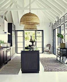 Safari style meets French perfection in this beautiful Colonial home in Saint Barth, in the French West Indies. Using a restrained black and white colour palette, the high ceiling, exposed beams and large windows create a feeling of wide open space and relaxation. The interiors complement the architecture without overpowering it.
