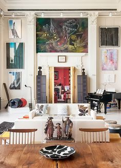 Create a gallery wall with a creative collection of artworks and take advantage of your towering high ceilings