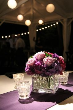 K Centerpiece Only Pretty Minus The Greenery Also Nice Square Vase Find This Pin And More On Purple Weddings