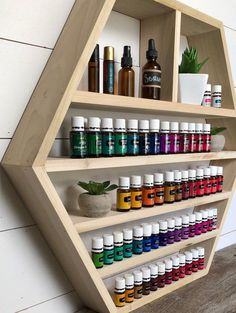Essential Oil Shelf Essential O Essential Oil Holder, Essential Oil Storage, Essential Oil Bottles, Young Living Oils, Young Living Essential Oils, Pharmacy Design, Hexagon Shelves, Display Shelves, Home Decor