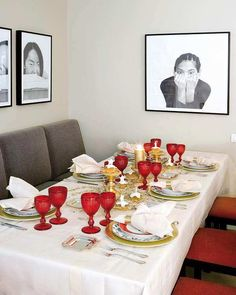 Medium White Dinner Table With Red Cups Golden Candle And Picture Frame