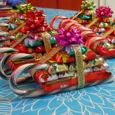 Candy Sleighs 	2 candy canes 1 regular size Kit Kat bar 10 mini Hershey candy bars (variety pack) ribbon hot glue