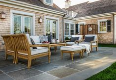 Patio Stones. Large stone tiles give the back patio a classic look that easily hides dirt and makes cleaning a breeze.
