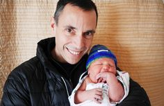 Knitting Doctor Robert Sansonetti with newborn