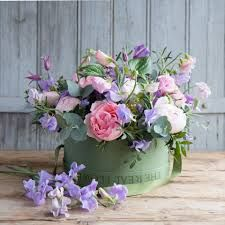 Overflowing stems of luxuriously scented English Sweet Peas, herbs and foliage are beautifully showcased in our signature green hat boxes. Flower Company, Green Hats, Hat Boxes, Real Flowers, Planter Pots, Floral Wreath, Wreaths, Sweet Peas, Plants