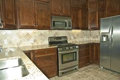 New Modern Kitchen. A kitchen in a new home. Dark cabinets, granite, tile and st , Kitchen In, Kitchen Cabinetry, Kitchen Modern, Cabinet Island, Rev A Shelf, Island Design, Dark Cabinets, Traditional Kitchen, Shabby Chic Style
