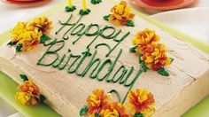 Enjoy this distinctive spiced cake decorated with flowers made from fruit roll snacks – a beautiful birthday treat!