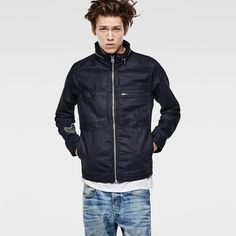 Slim denim jacket with chunky metal zips and an embroidered collection logo on the inner arm. Hem and cuffs are adjustable.