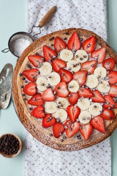 "Blogger @Cindy | Hungry Girl Por Vida  makes a tasty dessert ""pizza"" with a peanut butter cookie base topped with more peanut butter, bananas and fresh berries."